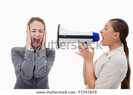 Manager yelling at her colleague through a megaphone against a white background