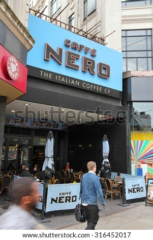 MANCHESTER, UK - APRIL 21, 2013: People drink coffee at Caffe Nero in Manchester, UK. Caffe Nero was founded in 1997 and has 700 coffee houses in 7 countries.