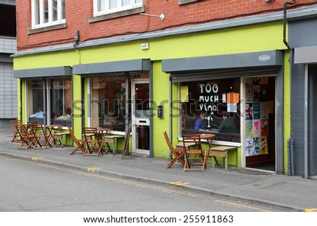 MANCHESTER, UK - APRIL 22, 2013: People eat at A Place Called Common in Manchester, UK. Greater Manchester is the 3rd most populous urban area in the UK (2.2 million people).