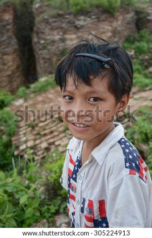 MANDALAY, MYANMAR - AUGUST 01: Unidentified Burmese children smiling with thanaka paste on the face posing on August 01, 2015 in Mandalay, Myanmar