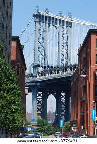 Manhattan Bridge Viewed from Brooklyn with the Empire State Building Visible Within Its Arch