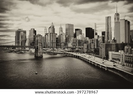 Manhattan skyline with Brooklyn Bridge. Downtown panorama view with big skyscrapers, New York City. Building tops financial district. Business background. Vintage, retro postcard with sepia filter.