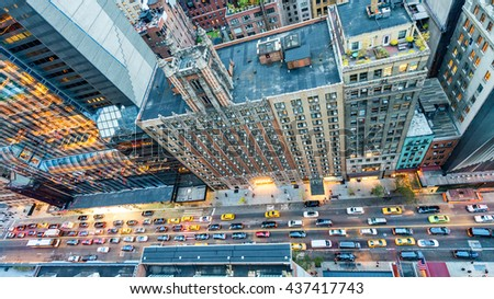 Manhattan streets at night, aerial view from rooftop.