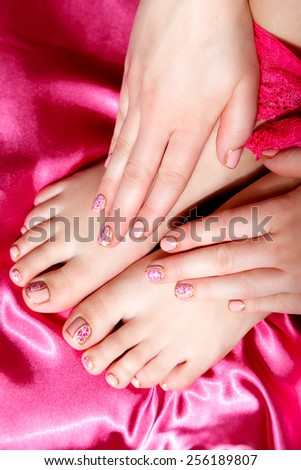 Manicured and pedicured painted nails
