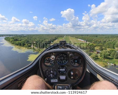 MANOTICK, CANADA - AUGUST 19: The view from the front seat of a glider approaching Rideau Valley Soaring on August 19, 2012 above Manotick, Ontario. The club offers flights to the public.