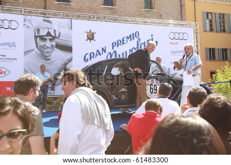 MANTUA, ITALY - SEPTEMBER 19: A 1938 Lancia Aprilia parades at Gran Premio Nuvolari in honor of famous Italian car champion Tazio Nuvolari September 19, 2010 in Mantua, Italy.