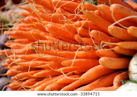 many carrots - vegetable market