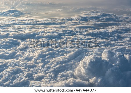Many cloud in fly above blue sky, outside airplane