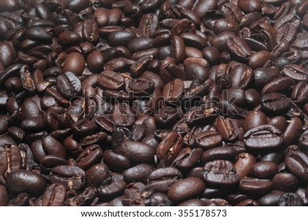 Many coffee beans brown. Hot drink. Background.