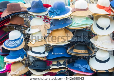 Many collection hat on rack in market