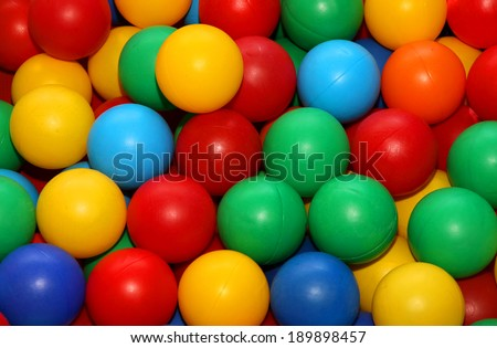 many colored balls for play fun in a swimming pool