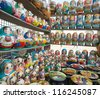 Many colorful russian dolls in a rows - stock photo