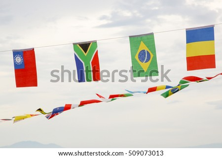 Many different flags against blue sky