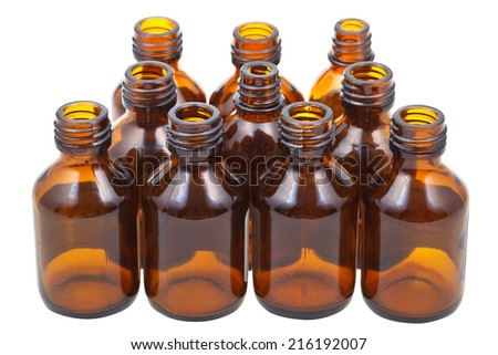 many little open brown glass oval pharmacy bottles isolated on white background