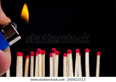 many red matches on black background witch lighter