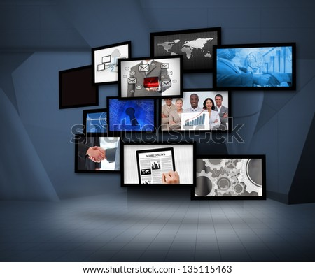 Many screens showing business images under a spotlight on digital background