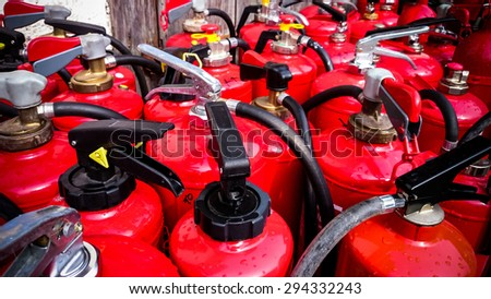 Many Used Fire Extinguishers, Top View, As Background