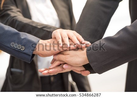 many Young Businessmen handshake in black suit