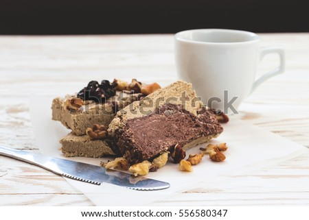 Marble sesame halva with cocoa and cup of coffee for breakfast.