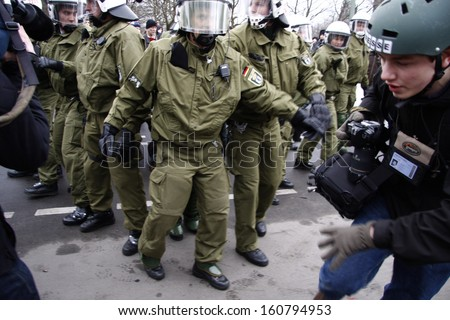 "MARCH 28, 2009 - BERLIN: ""riot police forces arrest a protester - protests against the banking crisis in Europe in Berlin."