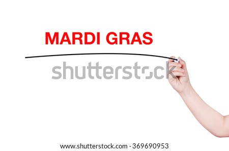 Mardi Gras word write by woman hand holding highlighter pen