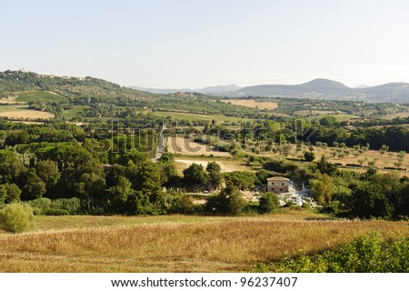 Maremma (Tuscany, Italy), country landscape with thermal bats at summer near Saturnia