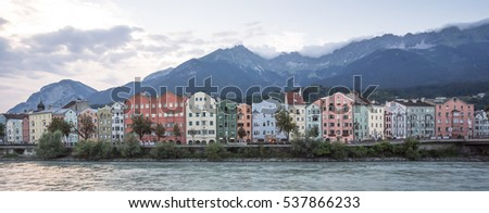 Mariahilfer street, Mariahif-St. Nikolaus district, Innsbruck, Austria-August 28, 2016: A line of fine colorful houses, restaurants, hotels and shops on the left bank of river Inn