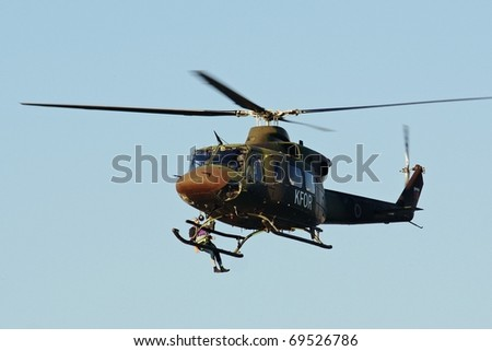 MARIBOR, SLOVENIA - JULY 15: Bell 412 demonstrates rescue action on Airshow on July 9, 2010 in Maribor, Slovenia