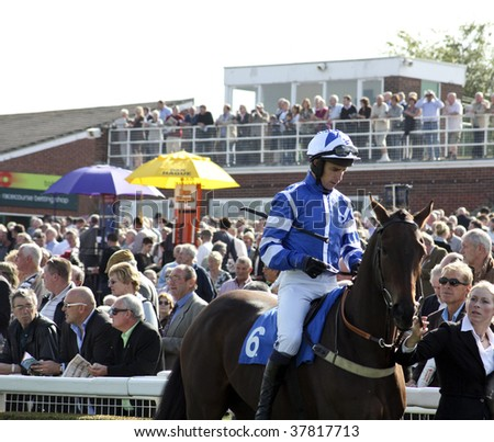 MARKET RASEN, LINCOLNSHIRE -  SEPTEMBER 26: J Leighton Aspell parades before the first race with Peachey Moment at Market Rasen Racecourse, UK September 26, 2009 in Market Rasen, Lincolnshire.