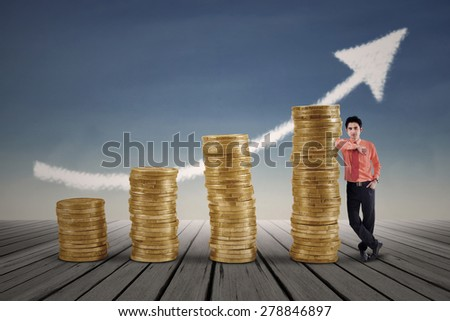 Marketing agent and rising gold coins chart with blue sky background