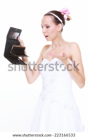 Marriage and money concept of high wedding cost. Bride with empty purse looking surprised isolated