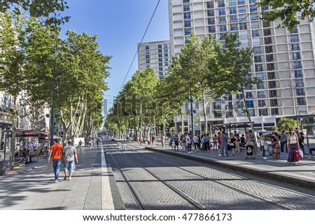 MARSEILLE, FRANCE -JULY 9, 2015: people wait for the streetcar in the town of Marseilles, France. Marseille runs a wide net of streetcar connections to cover the local infrastructure.