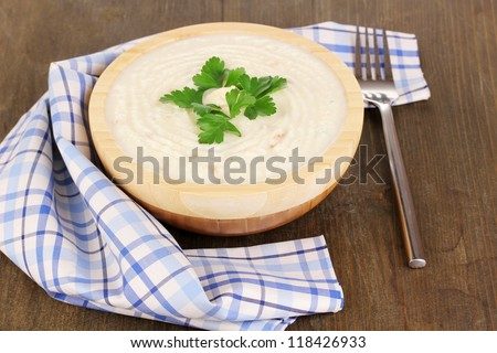 Mashed potatoes in wooden bowl on table close-up
