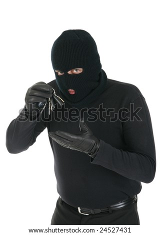 Masked criminal stealing house keys - isolated over the white background