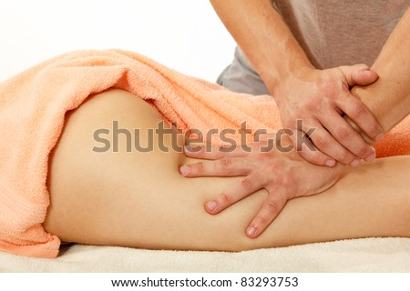 masseur makes anticellulite massage young woman isolated on white background