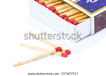 Matchbox with matches isolated on white background