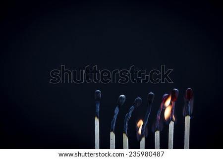 Matchsticks burning/ a row of lined up matches just at the end of burning