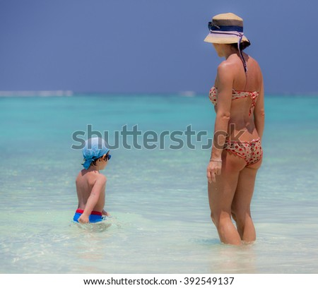 Mather and son on the beach of Maldive Island