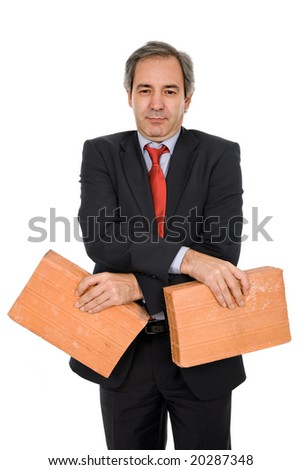 mature business man with two bricks, on white