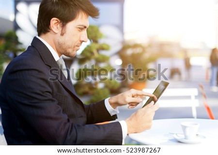 Mature businessman using a tablet outdoor