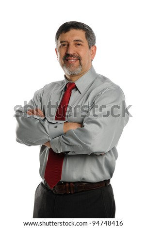 Mature Businessman with crossed arms smiling on a white background