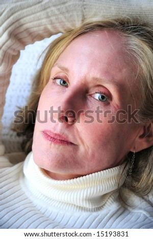 Mature businesswoman relaxing at home.