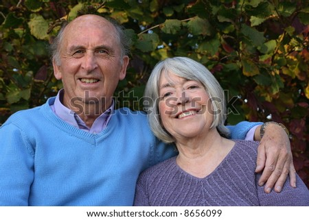 Mature couple in formal gardens.