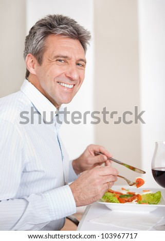 Mature man having lunch together at home
