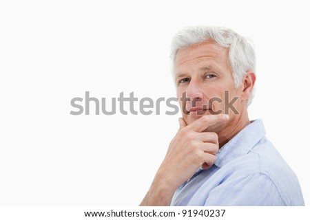 Mature man thinking against a white background