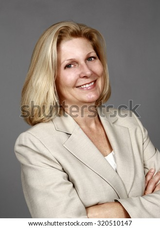 mature real woman in business suit smiling