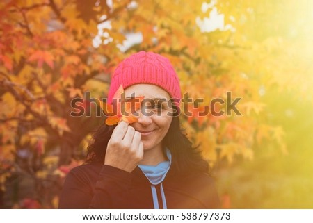 Matured woman with pink wool hat in the forest