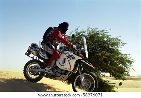 "MAURITANIA - JANUARY 6: Rider in the desert during the Budapest - Bamako Rally on January 6, 2006, Mauritania. Every year couple of hundred ""crazy"" leave Budapest for the 8000 km ride."