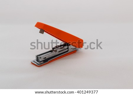 Max stapler with orange old on white background