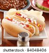 meal with hot dogs and toppings - stock photo